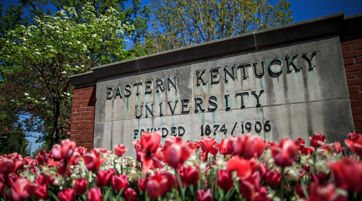 Eastern Kentucky University sign surrounded by colorful tulips